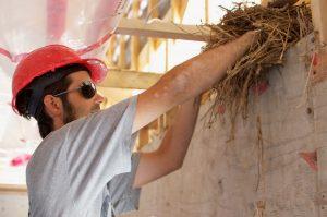 Installing straw/clay insulation