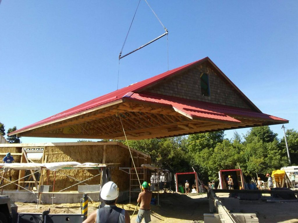 Craning a roof into place