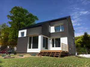 Photo of a grey sided modern house with porch