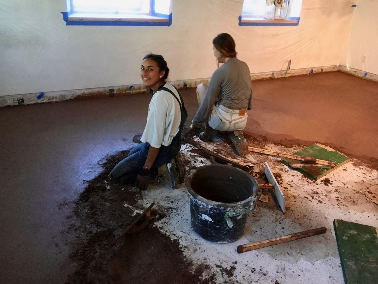 Image of student laying down concrete floor