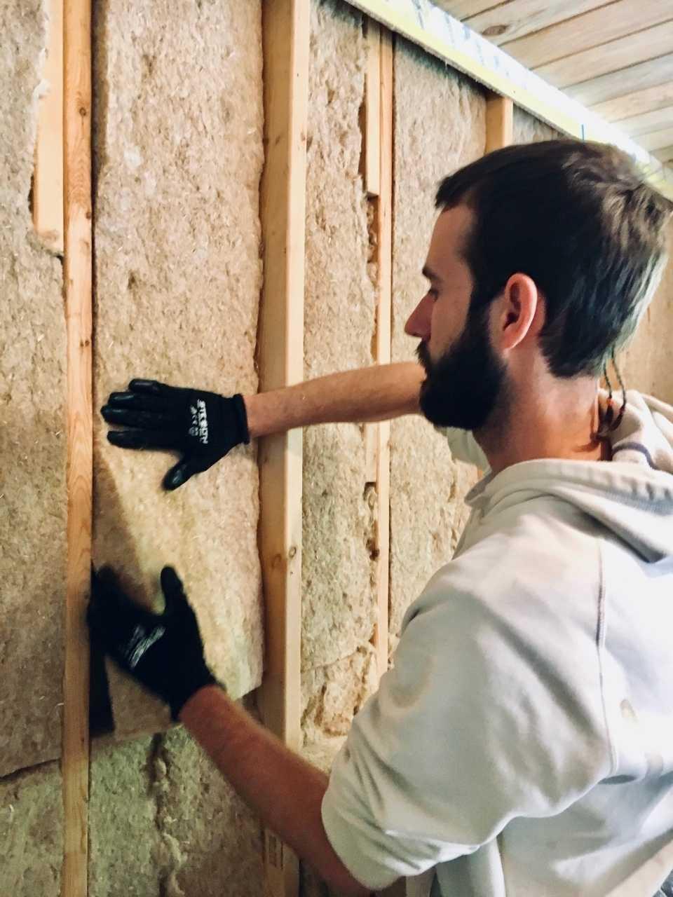 person installing hemp batts