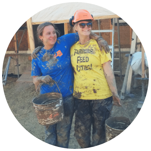 two women covered in plaster