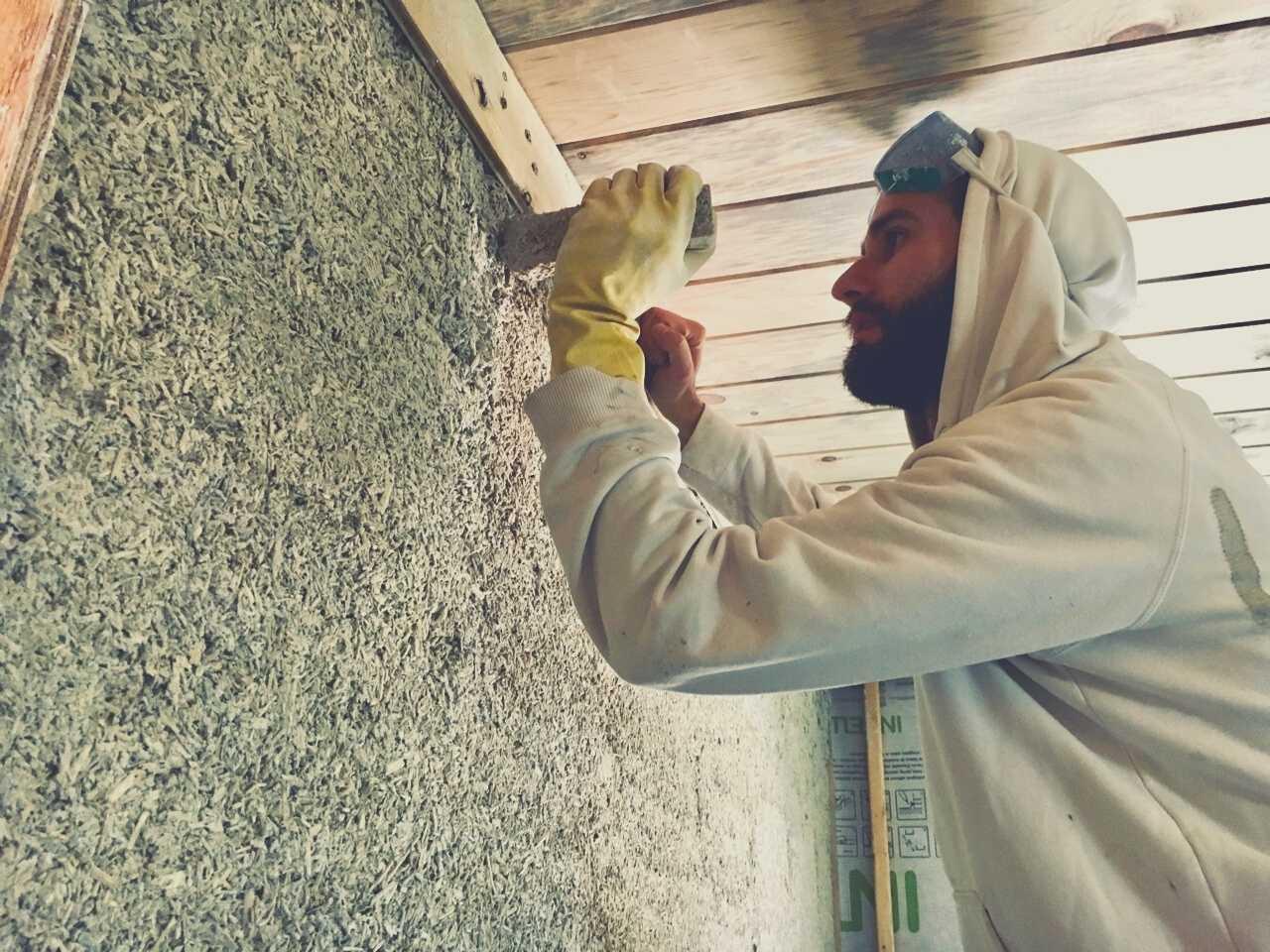 person installing hempcrete