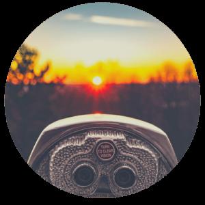 binoculors looking into sunset