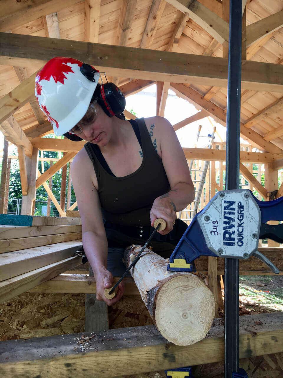 women peeling log