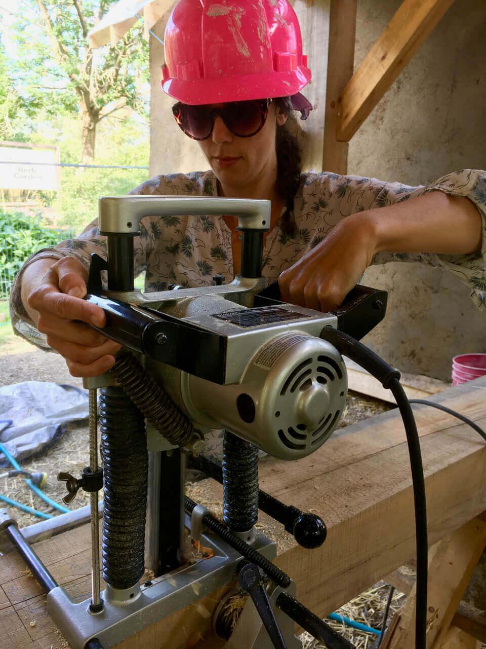 women using tool to timberframe
