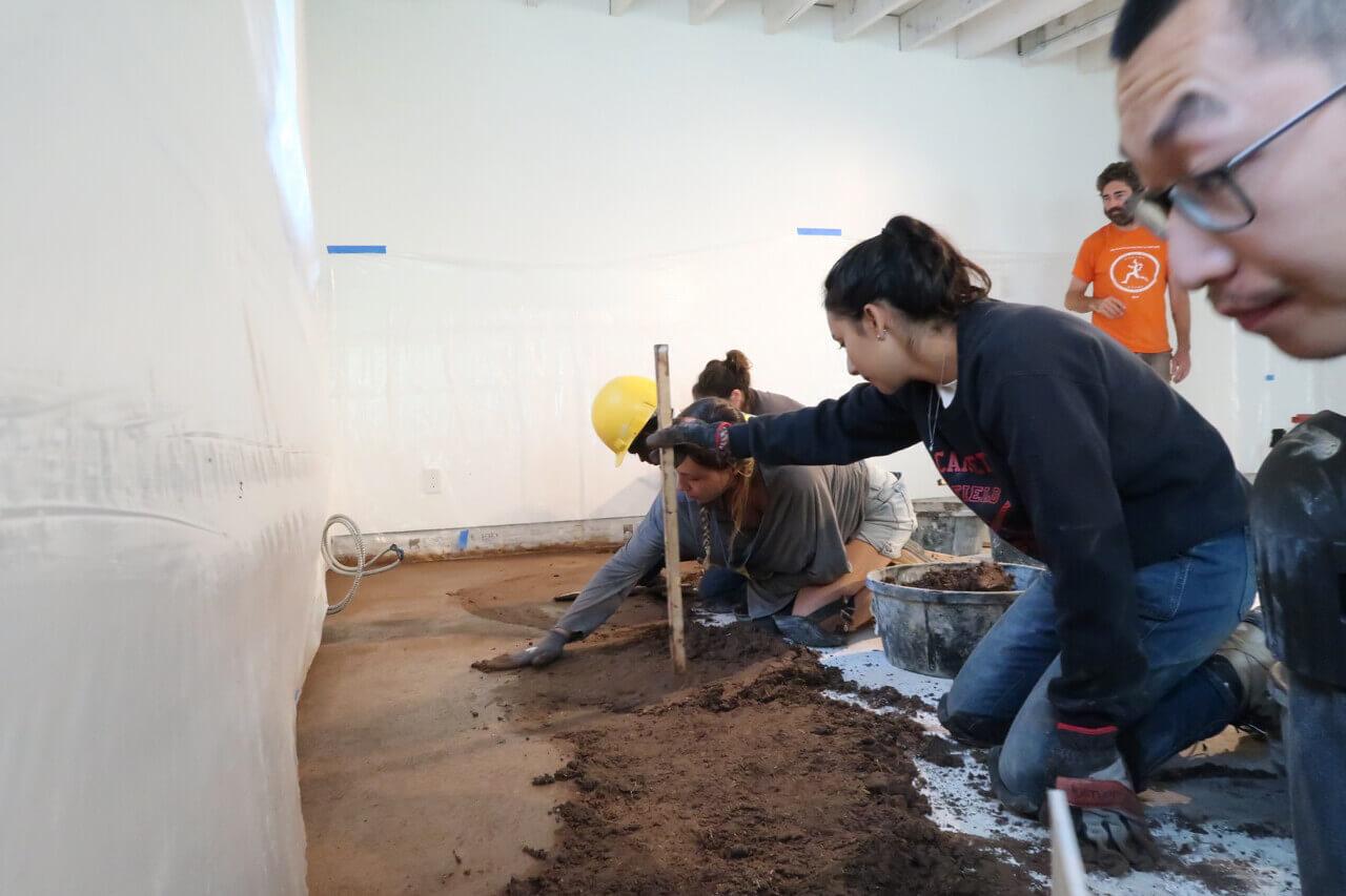picture of installing an earthen floor
