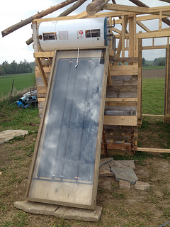 outhouse, solar hot water panel, homemade